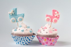 Is it a boy or a girl concept. Baby shower cupcake for a boy and a girl. Twins baby shower. Baby announcement. Retro style.