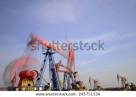 Is operation of pumping unit under the blue sky, close-up  #245751136
