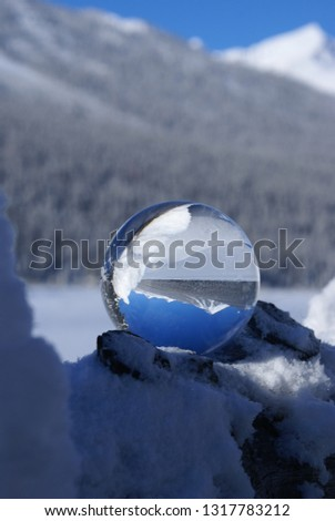 Is the glass sphere in the mountains, or are the mountains in the glass sphere? #1317783212