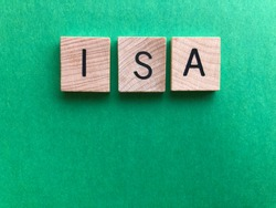 ISA / acronym for Individual Savings Account, in wooden alphabet letters on a plain green background with copy space. Creative concept, banking and finance