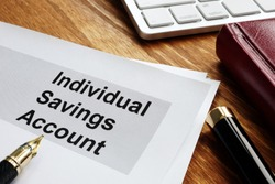 ISA Individual Savings Account. Business papers on an office desk.