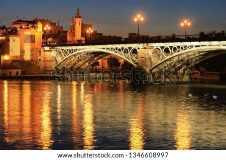 Isabel II bridge or Triana bridge over Guadalquivir river at twilight, Seville, Andalusia, Spain #1346608997