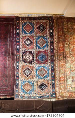 ISFAHAN, IRAN - JAN 7, 2014: Persian carpet on the wall of a shop in Iran, Jan 7, 2014. Persian carpet is an important part of Persian art and culture.