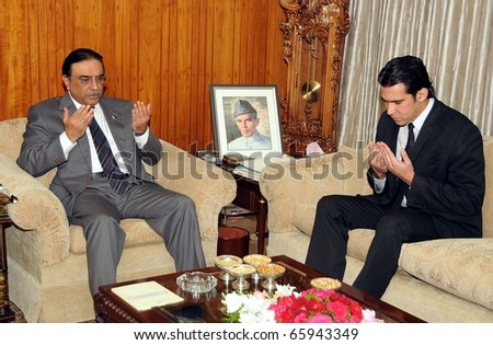 ISLAMABAD, PAKISTAN - NOV 24: President, Asif Ali Zardari, along with Aezaz-ur-Rehman offers pray for her mother Shama Khalid, former Governor of Gilgit-Baltistan, on November 24, 2010 in Islamabad. - stock photo