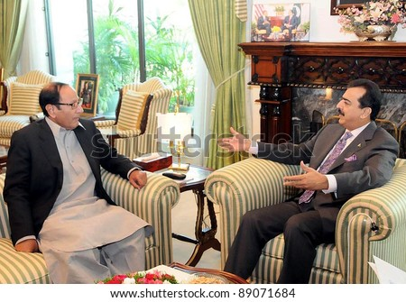 ISLAMABAD, PAKISTAN - NOV 17: Prime Minister, Syed Yousuf Raza Gilani talks with Muslim League-Q President, Ch.Shujaat Hussain during meeting at PM House on November 17, 2011in Islamabad.