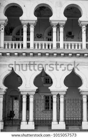 Islamic Architectural Arch of Window and Door of White Building as Ramadan Kareem and Eid Al Adha Greeting Card Background. Arabic Moorish Design of Contemporary Architecture #1015057573