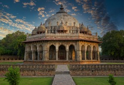 Islamic architecture tomb in Lodhi garden against dramatic sunset located in New Delhi - India
