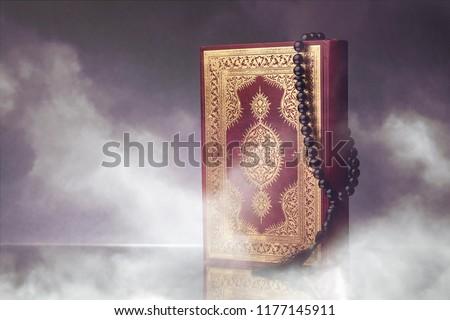 Islamic Book Koran with rosary on grey background #1177145911