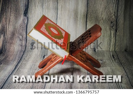 """Islamic concept for Ramadhan, the fasting month with """"Ramadhan Kareem"""" wordings and the Holy Qoran and Tasbih (rosary beads) against wooden background #1366795757"""