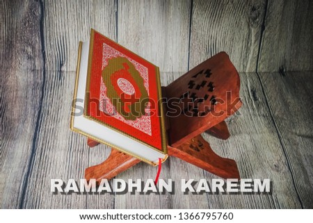 """Islamic concept for Ramadhan, the fasting month with """"Ramadhan Kareem"""" wordings and the Holy Qoran and Tasbih (rosary beads) against wooden background #1366795760"""