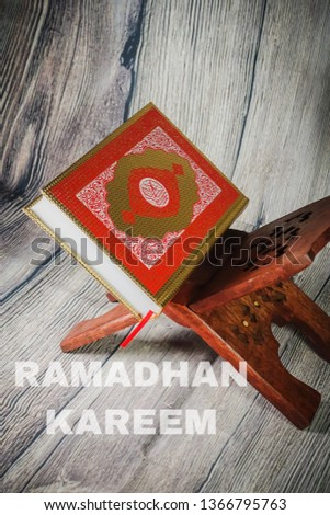 """Islamic concept for Ramadhan, the fasting month with """"Ramadhan Kareem"""" wordings and the Holy Qoran and Tasbih (rosary beads) against wooden background #1366795763"""