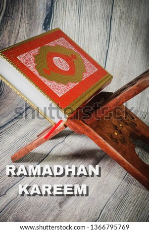 """Islamic concept for Ramadhan, the fasting month with """"Ramadhan Kareem"""" wordings and the Holy Qoran and Tasbih (rosary beads) against wooden background #1366795769"""