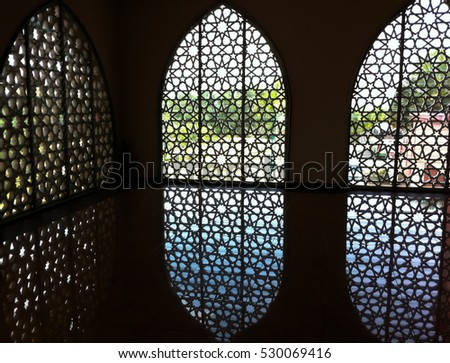 islamic design greeting background mosque window with arabic pattern #530069416