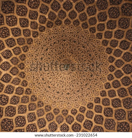 Islamic geometric pattern in Mosque. Islamic arabesque ornament on a mosque ceiling in Iran. Islamic ornament on a dome of a mosque.