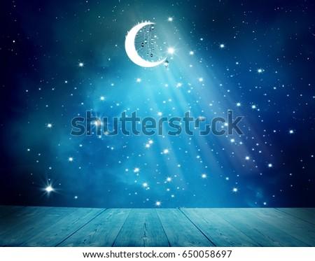 Islamic greeting  Eid Mubarak cards for Muslim Holidays.Eid-Ul-Adha festival celebration . Ramadan Kareem background.Crescent Moon and Lanterns Lightning in sky #650058697