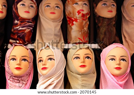 Islamic head scarfs on display in a middle eastern market - focus on front row