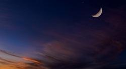Islamic Moon sky on Dark Blue Dusk,Twilight Sky in the Evening with Sunset and Beautiful Sunlight dark cloud and Crescent moon, symbol of religion islamic begin Ramadan month, Eid al-Adha, Eid al fitr