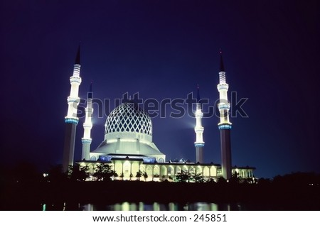 Islamic mosque lit up at night in Selangor Malaysia