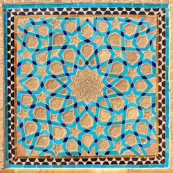 Islamic pattern of a mosaic in Iranian style outside Yazd Mosque, Iran. Tiled oriental ornaments from Iran are found in mosques and important buildings