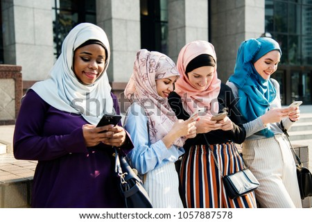 Islamic women using smartphone