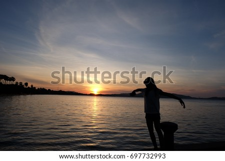 Island and sea with girl on blue sky