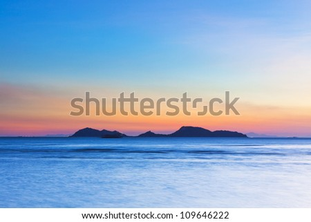 Island at sunset over the ocean