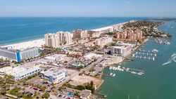 Island Clearwater Beach FL. Ocean or Gulf of Mexico shore. Spring break or Summer vacations in Florida. Hotels, restaurants and Resorts. Tropical Nature. Aerial view of city. United States of America.