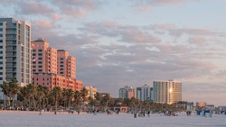Island Clearwater Beach FL. Ocean or Gulf of Mexico shore. Spring break or Summer vacations in Florida. Hotels, restaurants and Resorts. Tropical Nature with palm trees. United States of America.