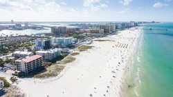 Island Clearwater Beach FL. Ocean or shore Gulf of Mexico. Spring break or Summer vacations in Florida. Hotels, restaurants and Resorts. Tropical Nature. Aerial view.