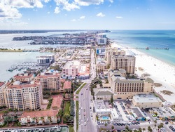 Island Clearwater Beach FL. Ocean or shore Gulf of Mexico. Spring break or Summer vacations in Florida. Hotels, restaurants and Resorts. United States of America. Tropical Nature. Aerial view.