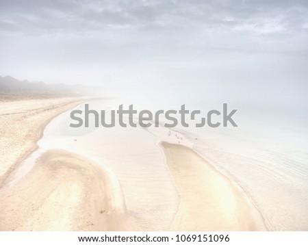 island coastline within misty...