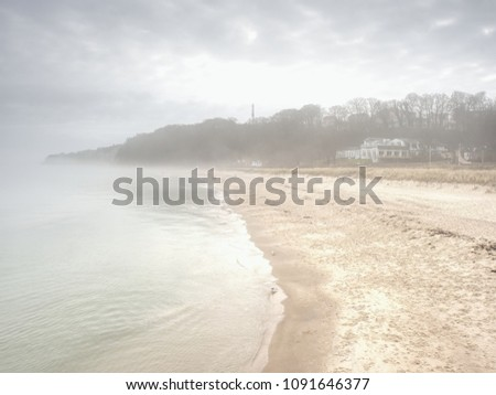 island coastline within misty...