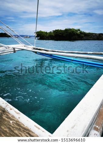 island hopping on crystal clear ocean on a pump boat #1513696610