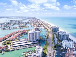 Island in Gulf of Mexico. Ocean or shore. Spring break or Summer vacations in Florida. Hotels, restaurants and Resorts. Tropical Nature. Clearwater Beach FL. Aerial view.