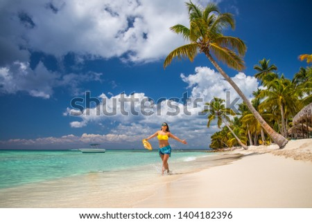 Island in the tropics. Happy girl enjoying tropical sandy beach, Punta Cana, Dominican Republic #1404182396