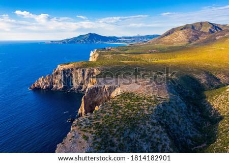 Island of Sardinia, western Mediterranean rugged coast, Italy. Mediterranean island of Sardinia (Sardegna), Italy. Cliffs at the western shore, Sardinia, Italy.