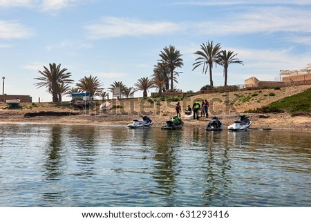 Island of Tabarca, Spain - March 11, 2017: Jet ski and people on the harbor of Tabarca Island. Spain