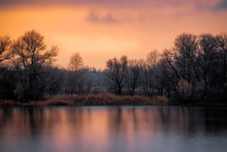 Island on the river in winter. Cold sunrise