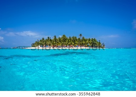 Island surrounded by crystal blue water in San Andres, Colombia