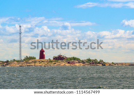 Island with a lighthouse #1114567499