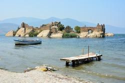 Island with ancient fortifications in Kapikiri village on Bafa lake in Mugla, Turkey.
