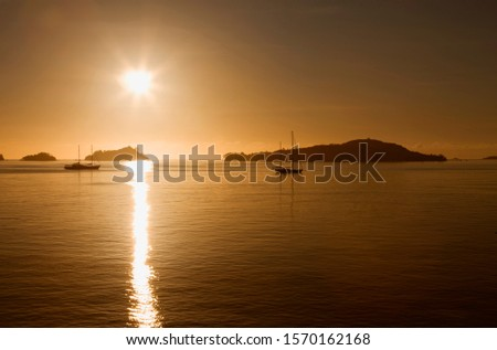 Islands in sunset, between Mahe Island and Praslin Island, Seychelles
