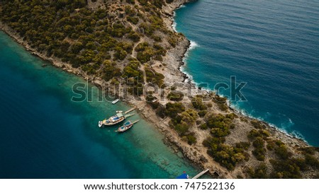 Islands in the Mediterranean Sea. Islands and peninsulas. Boats sail on the sea. Turkey Oludeniz Denizli Mugla Frame from the air. #747522136