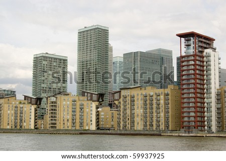 Isle of Dogs, viewed from the River Thames Modern office and apartment blocks in the Canary Wharf district of the Isle of Dogs, part of London's Docklands.  London.