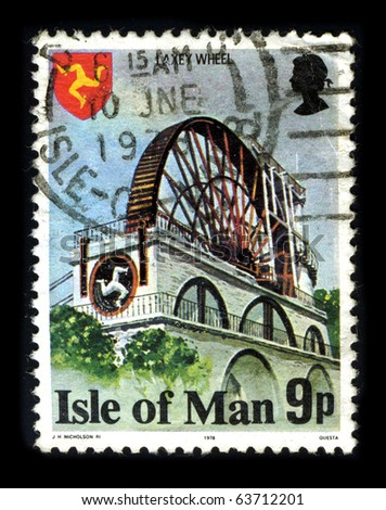 ISLE OF MAN - CIRCA 1978: A stamp printed in Isle Of Mann shows image of the dedicated to The Laxey Wheel  is a large waterwheel built in the village of Laxey in the Isle of Man circa 1978. - stock photo