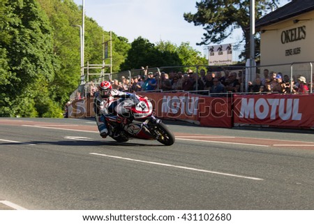 ISLE OF MAN, UK - June 03 2016: riders undertake qualifying laps of the annual TT (Tourist Trophy) Quater Bridge.