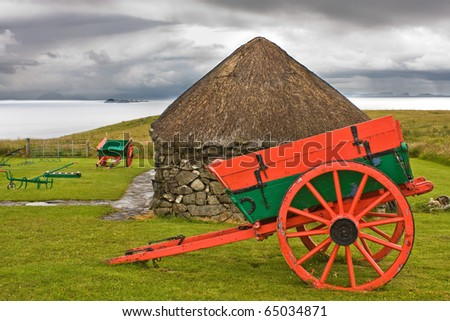 Isle of Skye: museum with old huts and carts in nature near the ocean with dramatic sky. Typical for Isle of Skye