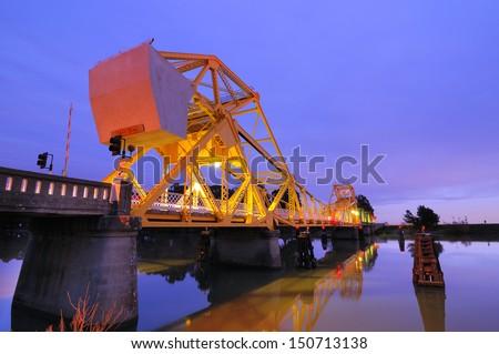 Isleton Bridge over the Sacramento River at Dusk. - stock photo