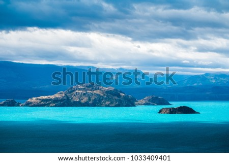 Islets in the middle of the lake with turquoise water. Lago General Carrera, Chile
