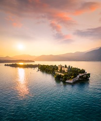 Isola del Garda with Villa Borghese during suynset. Aerial view. Garda Lake, Lombardy, Italy.